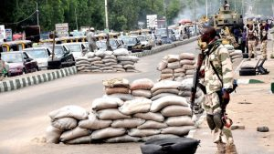 PIC.10.SOLDIERS ON GUARD ON POST OFFICE ROAD IN MAIDUGURI ON TUESDAY (20/5/14). 3106/20/5/2014/CH/AIN/NAN